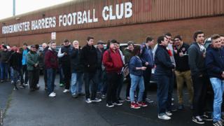 Kidderminster fans line up to enter the stadium