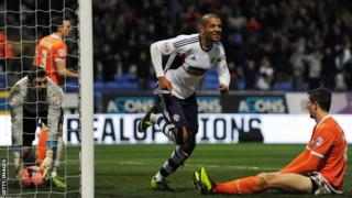 Bolton striker Jermaine Beckford celebrates scoring Bolton's winner against Blackpool