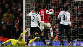 Arsenal midfielder Tomas Rosicky scores