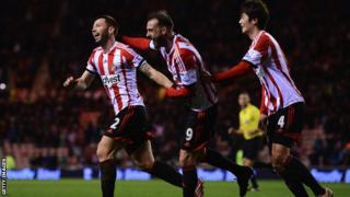 Phil Bardsley of Sunderland (left) celebrates Ryan Giggs of Manchester United scoring an own-goal