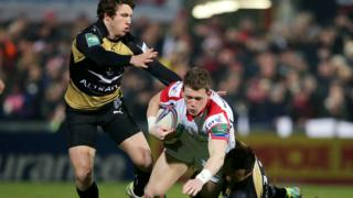 Ulster wing Craig Gilroy shrugs off the challenge of Yohann Artu and Anthony Tuitavake