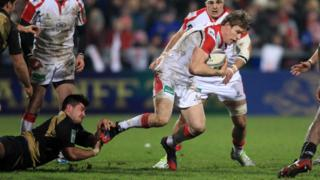 Lucas Dupont tackles Andrew Trimble during the match which saw the Ireland winger become Ulster's most capped player in European competition