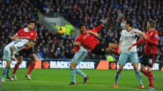 Cardiff forward Fraizer Campbell continues to trouble West Ham and has a penalty appeal turned down as he is challenged at a corner by George McCartney