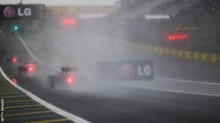 Cars approach a corner at the Brazil Grand Prix