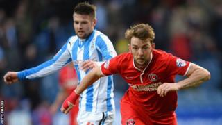 Oliver Norwood of Huddersfield challenges Charlton's Johnnie Jackson