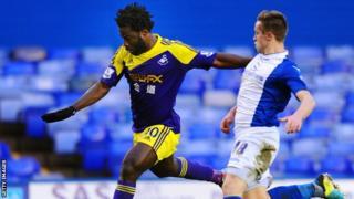 Swansea's Wilfried Bony takes on Birmingham's Mitch Hancox