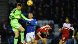 Middlesbrough goalkeeper Shay Given clears from Leicester City striker Jamie Vardy