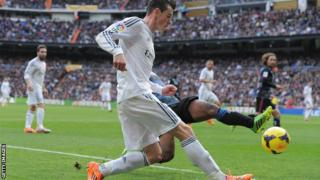 Gareth Bale had to be substituted at half time for Real Madrid, who won 2-0 to go top of La Liga.