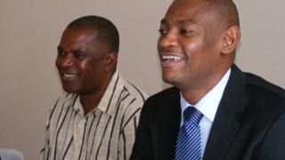 New Malawi coach Young Chimodzi and FAM president Walter Nyamilandu