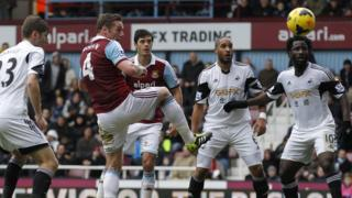 West Ham captain Kevin Nolan (second left) heads in his side's second against Swansea