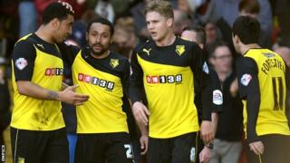 Watford's Ikechi Anya (second left) celebrates with his team-mates after scoring against Brighton