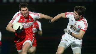 Derry's Mark Lynch attempts to make ground at the expense of Tyrone's Conon Grugan in Saturday night's Division One game