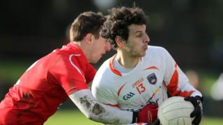 Padraig Rath and Jamie Clarke contend for possession during the Division Two clash between Louth and Armagh