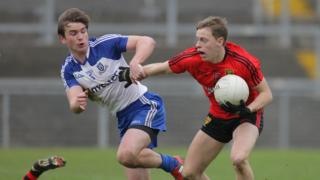 Monaghan's Dessie Mone is shrugged off by Down's Jerome Johnston in the Division Two clash at Pairc Esler