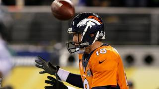 On the very first play from scrimmage, the ball is somehow snapped back over the head of non-plussed Denver quarterback Peyton Manning. The Broncos recover the ball, but in their own endzone at the cost of the two points awarded for a safety