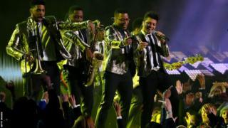 Bruno Mars (far right) kicks off the Super Bowl half-time show