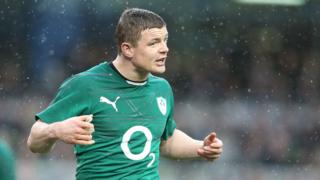Brian O'Driscoll celebrates after Ireland's comprehensive win set up a Triple Crown decider against England