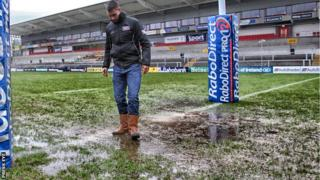 Referee Leighton Hodges carried out a pitch inspection