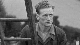 Sir Tom Finney up a ladder