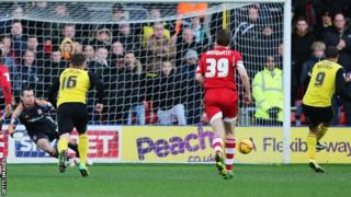 Watford striker Troy Deeney (right) scores against Middlesbrough from the penalty spot