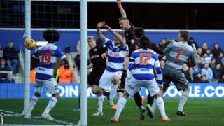 Reading's Alex Pearce scores against QPR with a header