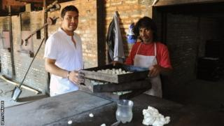 Salvador Cabanas (left) at the family's bakery in the town of Itagua, Paraguay
