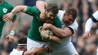 Gordon D'Arcy is tackled by Dylan Hartley in Saturday's clash at Twickenham