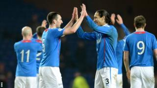 Rangers players celebrate securing the League One title
