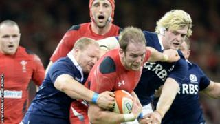 Two Scottish defenders grapple with Wales' Alun Wyn Jones