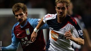 Stuart Holden (right) in action for Bolton