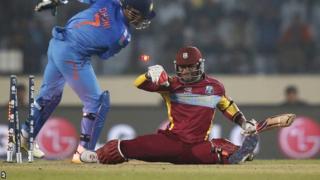 Marlon Samuels is stumped by India captain Mahendra Dhoni