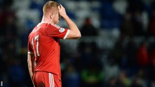 Adam Rooney rescued a point for Aberdeen against Ross County