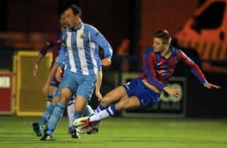 Andy Mitchell challenged by Warrenpoint captain Jonathan Cowan