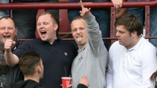 Celtic striker Leigh Griffiths (centre) joins Hibs fans at Sunday's Edinburgh derby