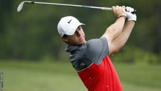 McIlroy watches his shot on the sixth hole in Houston