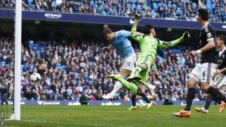 Manchester city striker Edin Dzeko (left) heads in his side's third against Southampton