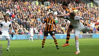 George Boyd of Hull City rises above Angel Rangel of Swansea to score the opening goal.