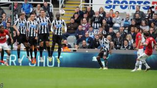 Juan Mata (right) curls in a free-kick to give Manchester United the lead at Newcastle