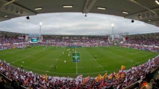 Ravenhill is packed to its new capacity of 18,000 with its redevelopment completed in time for the visit of Saracens