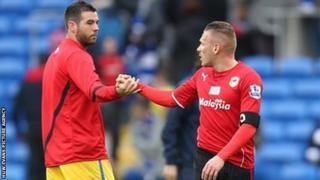 Crystal Palace's Joe Ledley shakes hands with Cardiff City's Craig Bellamy