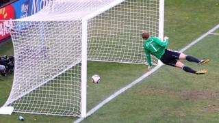 Germany's Manuel Neuer looks on as Frank Lampard's shot clearly crosses the line