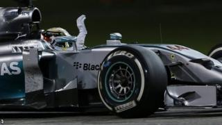 Mercedes driver Lewis Hamilton waves after he wins the Bahrain Formula One Grand Prix