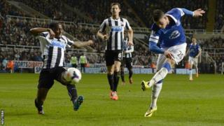 Everton's Ross Barkley (right) scores against Newcastle United