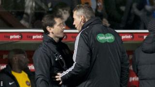 Dundee United boss Jackie McNamara is spoken to by the fourth official