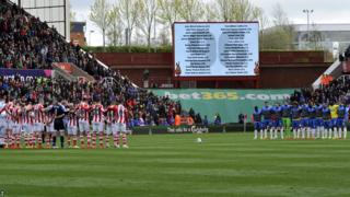 Names of the 96 Liverpool fans on the big screen before Stoke City v Newcastle United