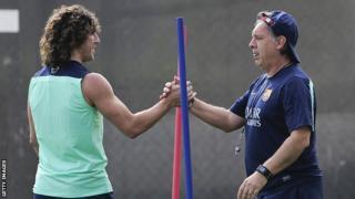 Barcelona's Carles Puyol and Gerardo Martino