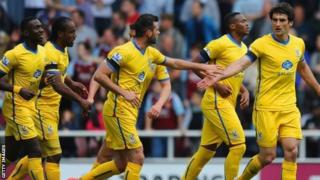 Mile Jedinak celebrates after scoring the winner against West Ham