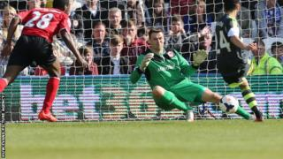 Cardiff's keeper David Marshall saves from Stoke's Oussama Assaidi