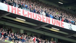 Manchester United fans at Old Trafford next to the David Moyes 'The Chosen One' banner