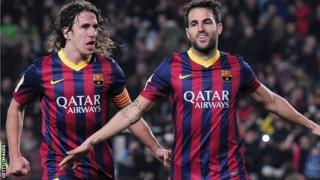 Carles Puyol and Cesc Fabregas